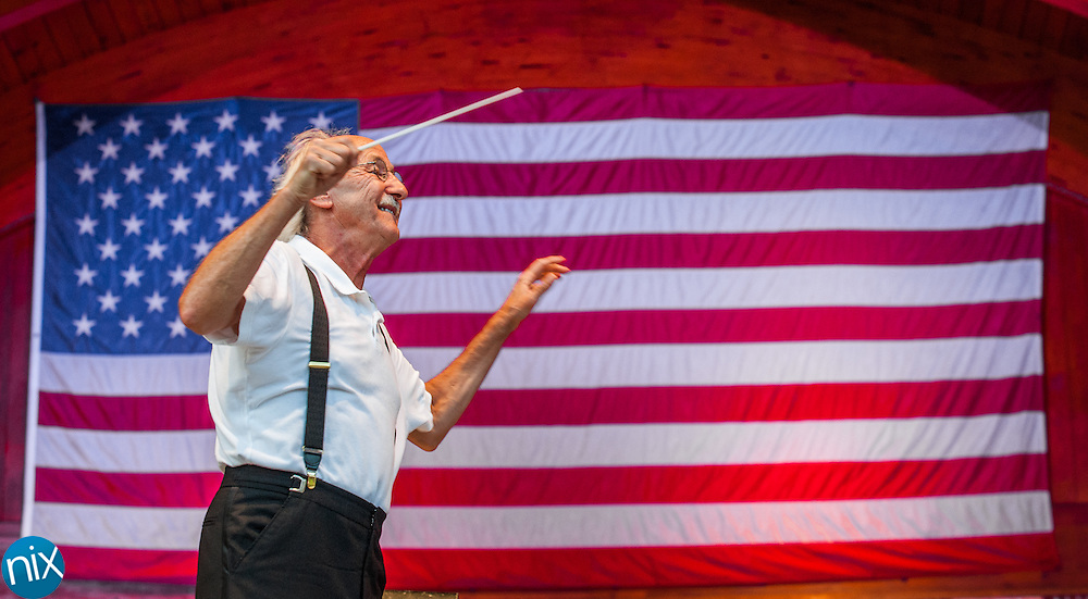 Albert-George Schram conducts the Charlotte Symphony during the Symphonic Stars & Stripes Salute at Village Park in Kannapolis on July 2, 2014.