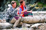 Alaska. Southeast. Couple enjoying picnic lunch, Woods spit MR