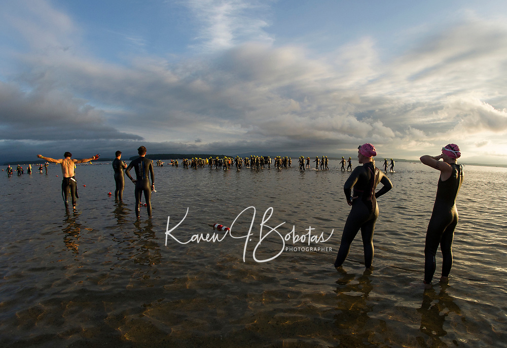 Athletes enter the water for the 1.2 mile swim of the Timberman 70.3.  (Karen Bobotas Photographer)