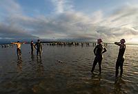 Athletes enter the water for the 1.2 mile swim of the Timberman 70.3.  (Karen Bobotas Photographer)