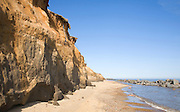 Soft crumbling cliffs with offshore rock armour, Happisburgh, Norfolk, England