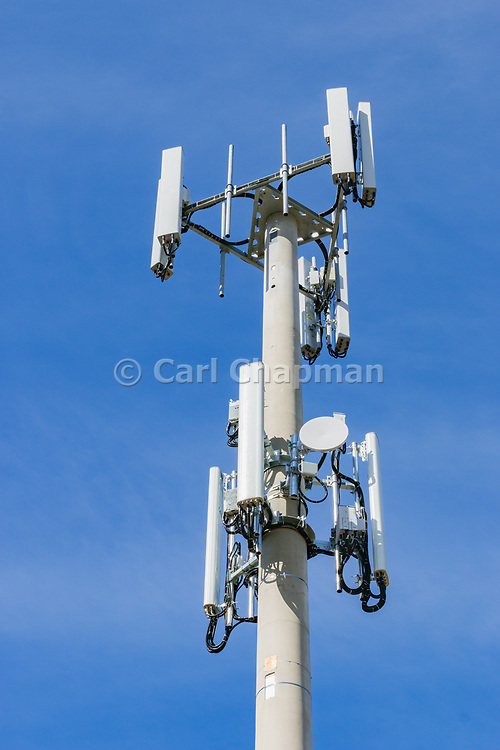 3 sector cellular telecom communications panel antenna array for the mobile telephone system on a cellsite pole tower . <br /> <br /> Editions:- Open Edition Print / Stock Image