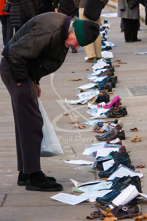 London, December 10th 2014. The shoes of hundreds of victims who died in Ireland, North and South during the Troubles are lined up opposite Downing Street as families demand that a proper investigation into over 3,600 deaths and 40,000 injuries on all sides, sets the truth free. PICTURED: Each pair of shoes has its own sad story and families longing for the truth.