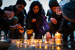 © Licensed to London News Pictures. 28/03/2016. London, UK. Candles are lit in London's Trafalgar Square as part of a vigil for the victims of the Easter Sunday suicide bombing in a busy public park in Lahore, Pakistan.A faction of the Pakistani Taliban, Jamaat-ul-Ahrar, has claimed responsibility for the attack which killed at least 70 people and wounding more than 300.  Photo credit : Rob Pinney/LNP