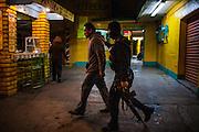 Police search for small time drug users and detain them, as part of a fight against Mexican drug war in Tijuana, Mexico. SPANISH: Un presunto vendedor de droga es detenido por un policía armado cuando intentaba escapar en Tijuana, México.