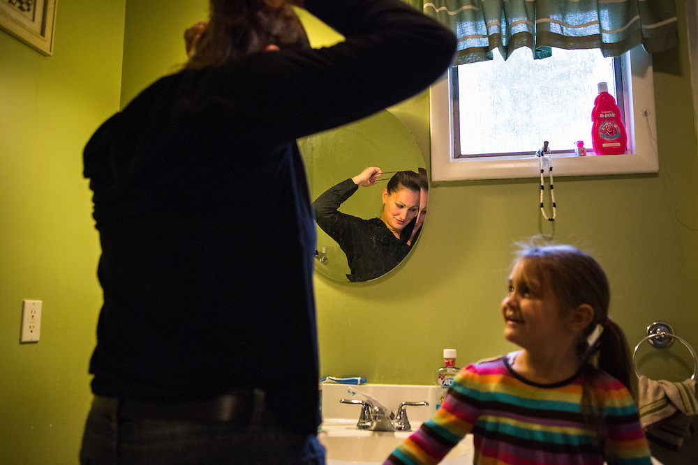 Sergeant Cheryl Crumley enjoys the company of her daughter, Taylor, as she gets ready at home. Sergeant Crumley is the first high ranking officer in the history of the Sullivan County Sheriff's Department.