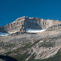 Portal Peak and Mount Thompson rise along the Rocky Mountain crest in Banff National Park, Alberta, Canada.