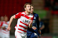Doncaster Rovers defender Tom Anderson (12) in action  during the EFL Sky Bet League 1 match between Doncaster Rovers and Southend United at the Keepmoat Stadium, Doncaster, England on 12 February 2019.