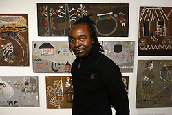 © Licensed to London News Pictures.12/11/2013. London, UK. Elson Kambalu, an artist from Malawi poses for a photography with his artwork at the Wellcome Collection's Foreign Bodies, Common Ground exhibition. The exhibition features works exploring health by artists from six countries, made during residencies in medical research centres in Malawi, Vietnam, Kenya, South Africa, the UK and Thailand. Photo credit : Peter Kollanyi/LNP