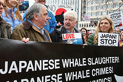 © Licensed to London News Pictures. 26/01/2019. London, UK. Former Foreign Secretary Boris Johnson's girlfriend Carrie Symonds (R) attends the protest against Japanese Whaling demonstration in central London along with Stanley Johnson (C).  Photo credit: Dinendra Haria/LNP