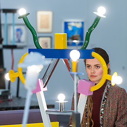 """© Licensed to London News Pictures. 01/11/2016. London, UK. A staff member views """"Ashoka lamp"""" by Ettore Sottsass, est. GBP800-1,200. The first look of """"Bowie / Collector"""", artworks from the late David Bowie's personal art collection, ahead of their sale later this month at Sotheby's. Photo credit : Stephen Chung/LNP"""