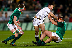 Charlie Watson of England U20 is tackled by John McKee of Ireland U20 - Rogan/JMP - 21/02/2020 - Franklin's Gardens - Northampton, England - England U20 v Ireland U20 - Under 20 Six Nations.