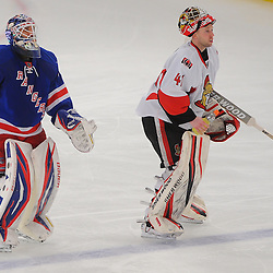 April 14, 2012: New York Rangers goalie Henrik Lundqvist (30) and Ottawa Senators goalie Craig Anderson (41) pass during a break in second period action of Game 2 of the NHL Eastern Conference Quarter-finals between the Ottawa Senators and New York Rangers at Madison Square Garden in New York, N.Y.