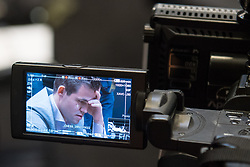 Norwegian reigning champion Magnus Carlson is seen on a television camera monitor during his tie-break matches against American challenger Fabiano Caruana at the FIDE World Chess Championship match, at the College, in Holborn, London.