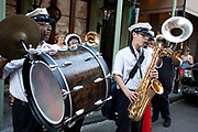A jazz band playing in a second line for a wedding, in true New Orleans style, around the French Quarter, New Orleans, Louisiana, USA.