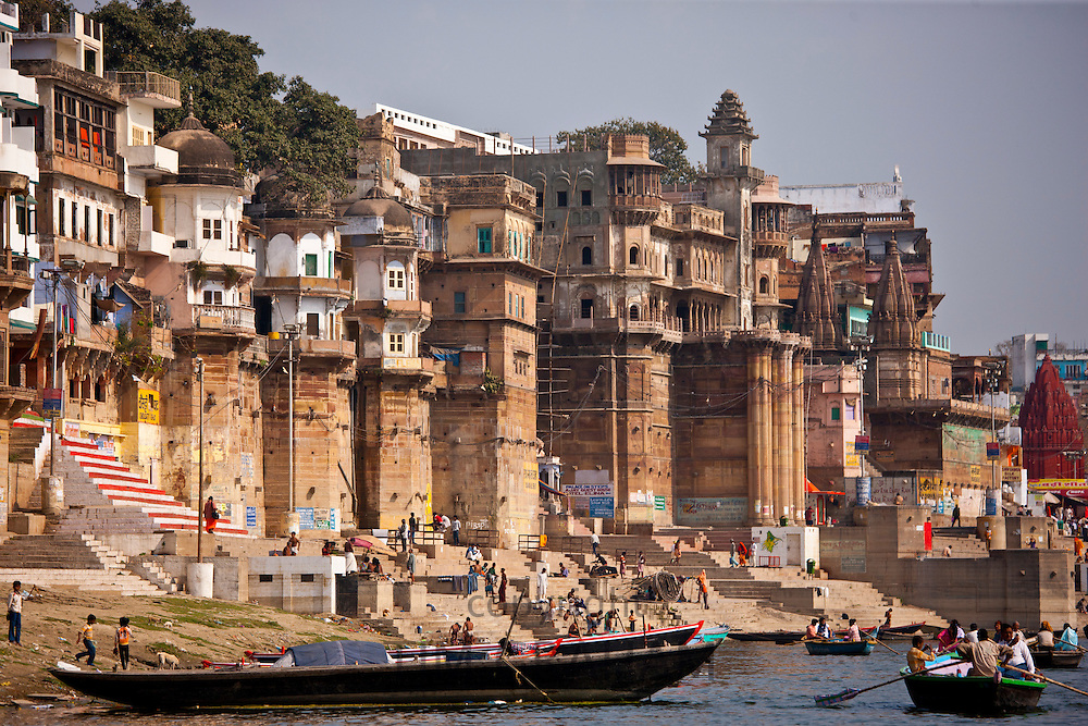 Tourists in boats at Ranamahal Ghat and Chousatti Ghat watch traditional bathing in Varanasi, India