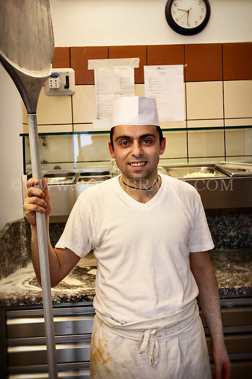 Italian pizza chef in the kitchen of Pizzeria Donna Stella, Amalfi, Italy.