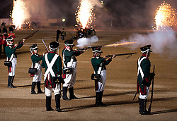 © Licensed to London News Pictures. 13/06/2012. LONDON, UK. As fireworks detonate in the background re-enactors of the 'Moscow Militia' fire their muskets during a performance of Tchaikowsky's '1812 Overture' at the annual Beating Retreat parade at Horse Guards Parade in London. On two successive evenings each year in June a pageant of military music, precision drill and colour takes place on Horse Guards Parade in the heart of London when the Massed Bands of the Household Division carry out the Ceremony of Beating Retreat. 300 musicians, drummers and pipers perform this age-old ceremony. The Retreat has origins in the early days of chivalry when beating or sounding retreat pulled a halt to the days fighting. Photo credit: Matt Cetti-Roberts/LNP
