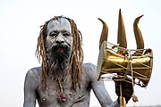 A sadhu smeared with with the white ashes of cremated hindus.