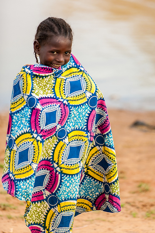 Portrait of a young Fulani girl near a local waterhole in northern Burkina Faso. The Fulani or Peul are nomadic herdsmen of the Sahel region of West Africa.