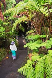 woman visitor, entering Thurston Lava Tube, Hawaii Volcanoes National Park, Kilauea, Big Island, Hawaii, USA, MR