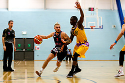 Jordan Nicholls of Bristol Flyers takes on Ladarius Tabb of London Lions  - Photo mandatory by-line: Robbie Stephenson/JMP - 10/04/2019 - BASKETBALL - UEL Sports Dock - London, England - London Lions v Bristol Flyers - British Basketball League Championship