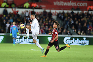 Ashley Richards of Swansea city breaks away from Eduardo Vargas of QPR. Barclays Premier league match, Swansea city v Queens Park Rangers at the Liberty stadium in Swansea, South Wales on Tuesday 2nd December 2014<br /> pic by Andrew Orchard, Andrew Orchard sports photography.