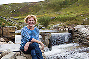 Jaqui Bugden founding director of Ynni Anafon Energy at the weir of their new community hydro project. Ynni Anafon Energy, one of the largest community owned hydro projects in the UK. The site of the Anafon Hydro lies in the Anafon valley in the Carneddau massif which rises immediately south of the village of Abergwyngregyn just inside the northern boundary of the Snowdonia National Park and 4 km west-south-west of Llanfairfechan.