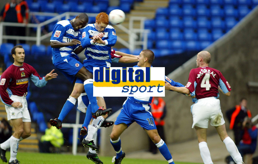 Fotball<br /> 2004/2005<br /> Foto: SBI/Digitalsport<br /> NORWAY ONLY<br /> <br /> Reading v Burnley<br /> The League Championship. 02/10/2004<br /> <br /> From left  Ibrahima Sonko Dave Kitson and Ivar Ingimarsson of Reading goes up for an aerial ball with John McGreal of Burnley
