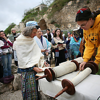 Jewish women of the Women of the Wall organization pray at the Western Wall,  Judiasm's holiest site in Jerusalem's Old City. Women of the Wall is a group of mostly religiously observant women who believe that women should be allowed to pray as a group at the Western Wall read from a Torah scroll and wear prayer shawls and phylacteries that in orthodox Judaism are used only by men.