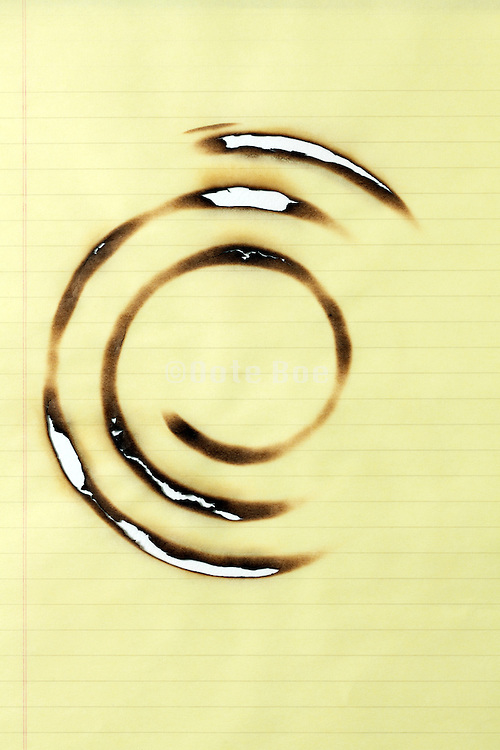 blank yellow lined notepad paper burned with a circular imprint