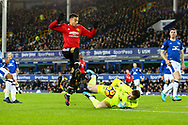 Everton Goalkeeper Jordan Pickford saves at the feet of Jesse Lingard of Manchester United. Premier league match, Everton v Manchester Utd at Goodison Park in Liverpool, Merseyside on New Years Day, Monday 1st January 2018.<br /> pic by Chris Stading, Andrew Orchard sports photography.