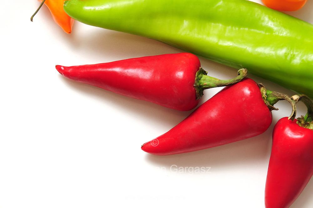 Chili peppers--Anaheim (long, light green); Red Fresno (red); Habanero (orange)