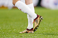 Huddersfield Town defender Florent Hadergjonaj (33), on loan from Ingolstadt, gold Adidas football boots during the Premier League match between Huddersfield Town and Chelsea at the John Smiths Stadium, Huddersfield, England on 12 December 2017. Photo by Simon Davies.