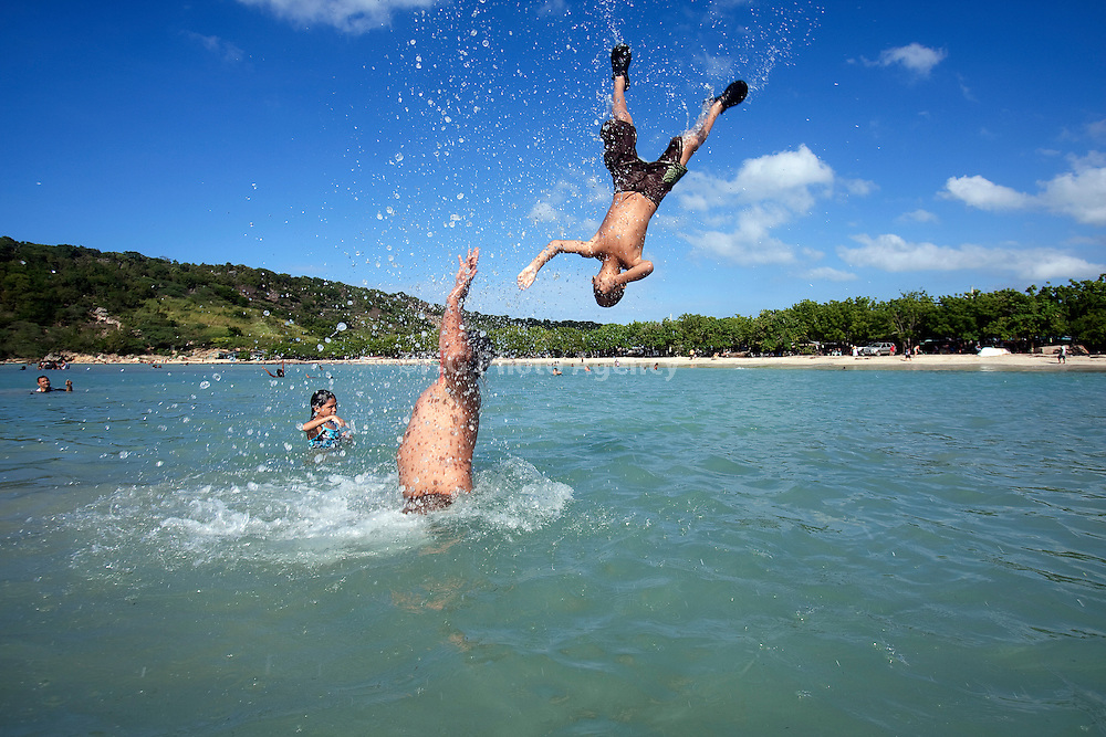 Kids play at beach in Dominican Republic.