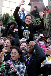 09 February 2010. New Orleans, Louisiana, USA. <br /> The fans go wild as Drew Brees leads the team when Saints Mania captures New Orleans like no other parade. The New Orleans Saints victorous NFL football team makes its way from the Superdome through the city. Drew Brees and the crew make their way through screaming fans. The team salutes the massed crowds along the victory parade route in downtown New Orleans following the team's stunning victory over the Indianapolis Colts for Superbowl 44. <br /> Photo ©; Charlie Varley. Varleypix.com