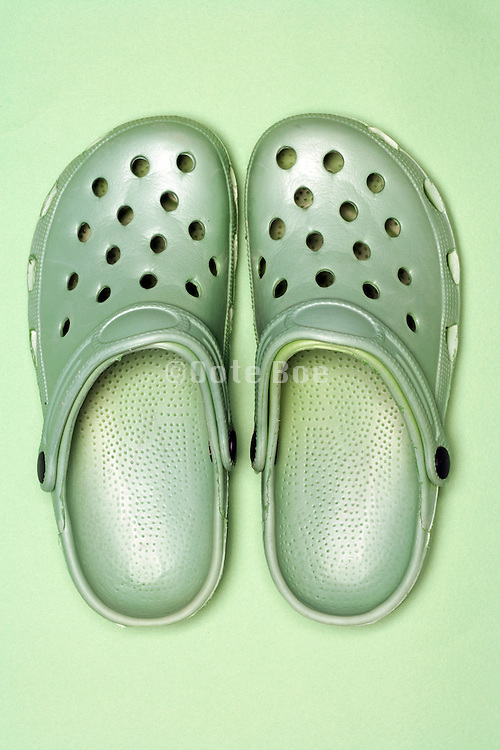 green crocs on a green background