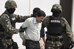 July 12, 2015 - Mexico City, Mexico - Joaquin 'El Chapo' Guzman, leader of the Sinaloa drug cartel, disappeared from the maximum-security Altiplano prison through a tunnel of more than 1.5 km long under his cell. PICTURED - Saturday February 22, 2014.  Joaquin Guzman Loera (a) El Chapo is taken into custody by the Mexican Navy in Mexico City. (Credit Image: © Prensa Internacional/ZUMA Wire)