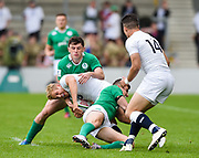 England full-back Max Malins is held in the tackle from Ireland wing Hugo Keenan and centre Shane Daly  during the World Rugby U20 Championship Final   match England U20 -V- Ireland U20 at The AJ Bell Stadium, Salford, Greater Manchester, England onSaturday, June 25, 2016. (Steve Flynn/Image of Sport)
