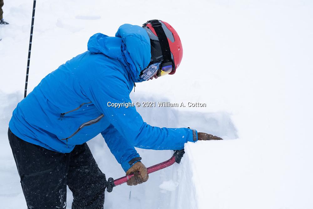 Diamond Peaks Ski Patrol director Owen Richard evaluates snowpack near Montgomery Pass by performing an extended column test, Feb. 6, 2021.