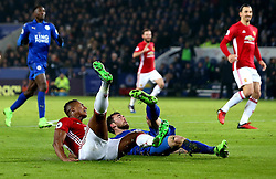 Luis Antonio Valencia of Manchester United and Christian Fuchs of Leicester City slide on the floor - Mandatory by-line: Robbie Stephenson/JMP - 05/02/2017 - FOOTBALL - King Power Stadium - Leicester, England - Leicester City v Manchester United - Premier League