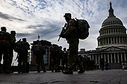 WASHINGTON, DC - JANUARY 16: Virginia National Guard soldiers arrive at the east front of the U.S. Capitol on January 16, 2021 in Washington, DC. After last week's riots at the U.S. Capitol Building, the FBI has warned of additional threats in the nation's capital and in all 50 states. According to reports, as many as 25,000 National Guard soldiers will be guarding the city as preparations are made for the inauguration of Joe Biden as the 46th U.S. President. (Photo by Samuel Corum/Getty Images)