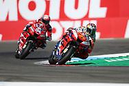 #43 Jack Miller, Australian: Alma Pramac Racing Ducati cuts the chicane ahead of #4 Andrea Dovizioso, Italian: Mission Winnow Ducati Team during the Motul Dutch TT MotoGP, TT Circuit, Assen, Netherlands on 29 June 2019.