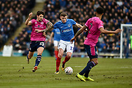 Portsmouth Midfielder, Dion Donohue (17) runs past Queens Park Rangers Midfielder, Pawel Wszolek (23) during the The FA Cup fourth round match between Portsmouth and Queens Park Rangers at Fratton Park, Portsmouth, England on 26 January 2019.