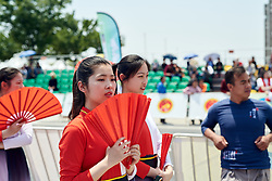 Dancers wait to take to the stage at Tour of Chongming Island 2019 - Stage 1, a 102.7 km road race on Chongming Island, China on May 9, 2019. Photo by Sean Robinson/velofocus.com