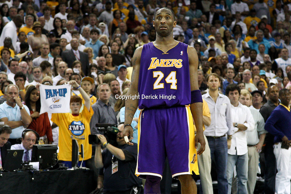 April 24, 2011; New Orleans, LA, USA; Los Angeles Lakers shooting guard Kobe Bryant (24) reacts during the fourth quarter in game four of the first round of the 2011 NBA playoffs against the New Orleans Hornets at the New Orleans Arena. The Hornets defeated the Lakers 93-88.   Mandatory Credit: Derick E. Hingle
