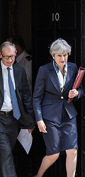 © Licensed to London News Pictures. 21/06/2017. London, UK. Prime Minister Theresa May leaves 10 Downing Street with her husband Philip on her way to the Queen's Speech for the State Opening of Parliament. Photo credit: Rob Pinney/LNP