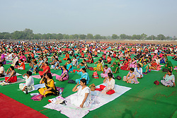 June 17, 2017 - Allahabad, Uttar Pradesh, India - People perform Yoga ahead of International Yoga day celebration at Parade Ground in Allahabad on 17-06-2017. International Day of Yoga, or commonly and unofficially referred to as Yoga Day, is celebrated annually on June 21st. (Credit Image: © Prabhat Kumar Verma via ZUMA Wire)