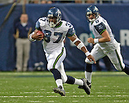 Seattle running back Shaun Alexander (37) rushes up field during game action against St. Louis at the Edward Jones Dome in St. Louis, Missouri, October 9, 2005. The Seahawks beat the Rams 37-31.