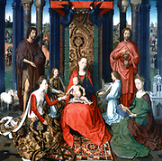 Altarpiece of St John the Baptist and St John the Evangelist, 1474-1479. Triptych. Oil on oak panel.  Hans Memling (1430/1440-1494) South Netherlandish painter.  Central panel: Virgin and Child, St Catherine of Alexandria.